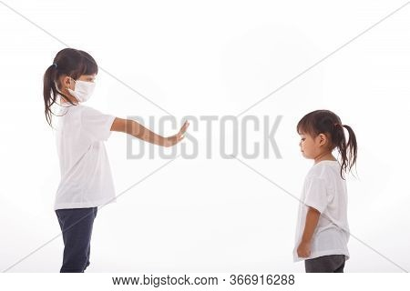 Social Distance Concept. Two Asian Kids Wearing Mask Standing Distance Of 2 Meter From Other People