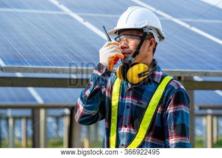 Engineer Checking Solar Panel In Routine Operation At Solar Power Plant,solar Power Plant To Innovat
