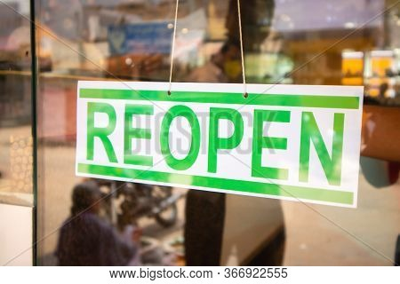 Reopen Signage Board In Front Of Businesses Or Store Door After Covid-19 Or Coronavirus Crisis- Conc