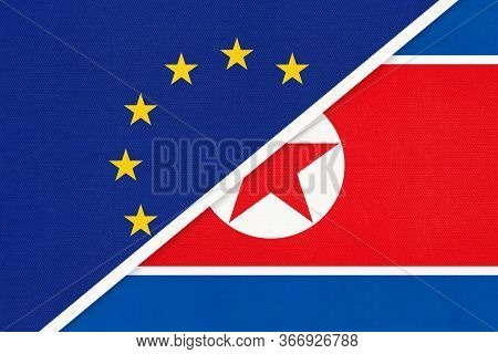 European Union Or Eu And North Korea National Flag From Textile. Symbol Of The Council Of Europe Ass
