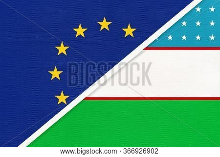 European Union Or Eu And Republic Of Uzbekistan National Flag From Textile. Symbol Of The Council Of