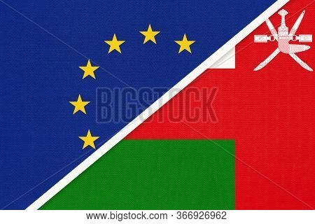 European Union Or Eu And Sultanate Of Oman National Flag From Textile. Symbol Of The Council Of Euro