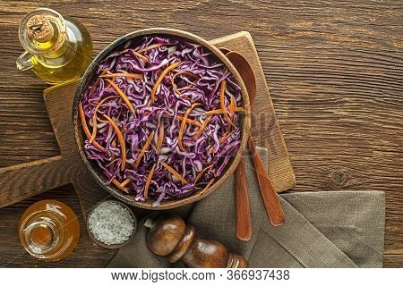 Healthy Vegetable Salad With Red Cabbage And Carrots On Wooden Table