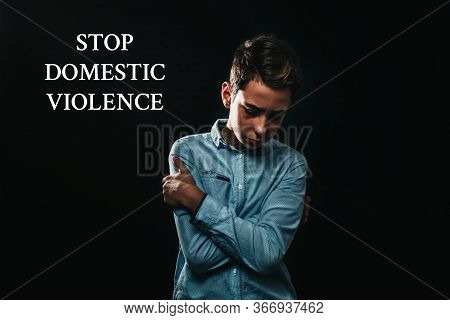 The Concept Of Domestic Violence. The Sad Teenage Boy Crossed His Arms Over His Chest In Defence Of