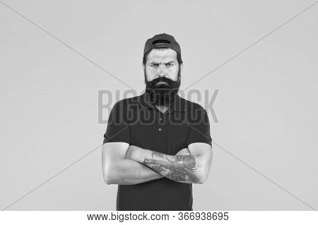 Masculinity. Hipster Life. Brutal Handsome Hipster Tattooed Man. Bearded Man Trendy Style. Beard And