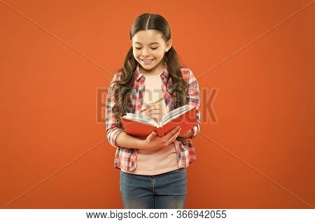 Study Language. Making Notes. Child Doing Homework Writing In Workbook. Girl Hold Book And Pen. Girl