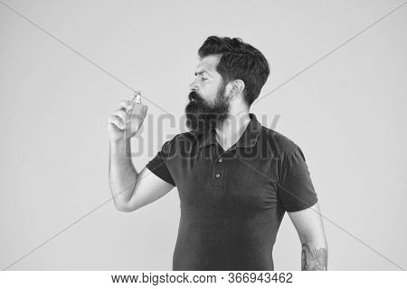 Man Well Groomed Bearded Handsome Hold Bottle Perfume. Freshness Concept. Wearing Perfume. Choose Pe