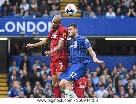 London, England - September 22, 2019: Fabio Henrique Tavares (fabinho) Of Liverpool (l) And Mateo Ko