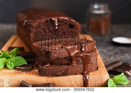 Brownie Is A Classic American Dessert. Chocolate Muffin With Chocolate Sauce And Mint.