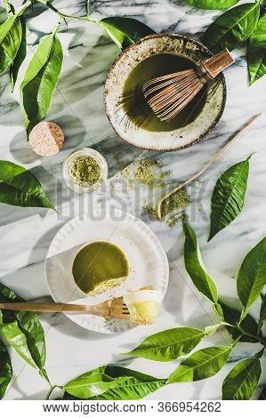 Flat-lay Of Green Matcha Cheesecake Dessert And Matcha Powder