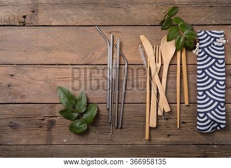 Eco-friendly Reusable Metal Drinking Straw And Cutlery  ( Spoon, Knife, Fork) On Wooden . Zero Waste