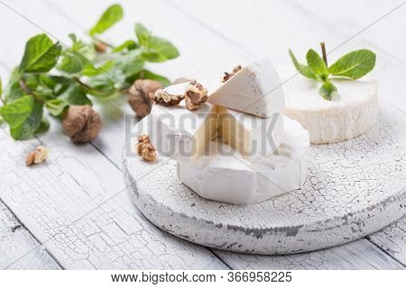 Camembert Cheese On A Wooden Board With Nuts, Honey And Mint. Italian, French Gourment Camembert Che