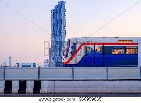 Bangkok-thailand Nov 12 2018: Bts Skytrain On Cityscape Background On Evening Time And Afterwork, Bt