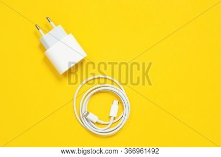 Wrapped In A Ring Usb Lightning Cable And Power Adapter For Charging Smartphones And Devices Or For
