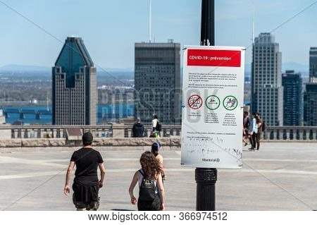 Montreal, Ca - 18 May 2020 : Sign Showing French Covid-19 Safety Guidelines And Montreal Skyline In