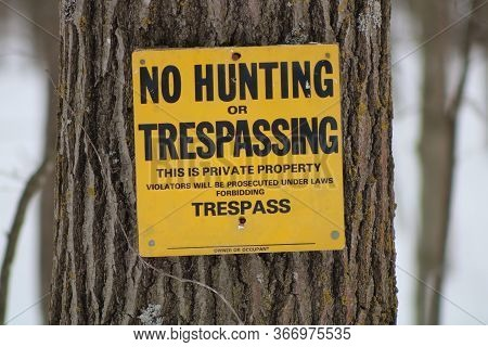 No Trespassing Sign Posted For Rural Wooded Property, Winter, Snow