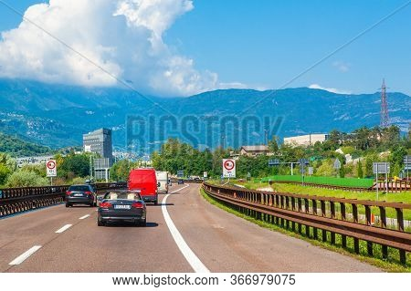 Trentino, Italy - 7may 2019: View Of The Autobahn Road In Italy, Surrounded By Mountains And The Lan