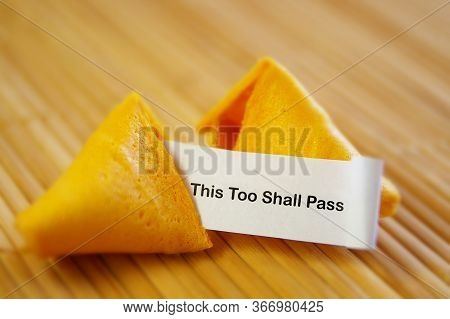 Fortune Cookie With This Too Shall Pass Message -- Optimism And Encouragement Concept