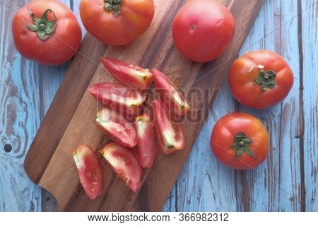 Top View Of Chopped Tomatoes On A Chopping Board