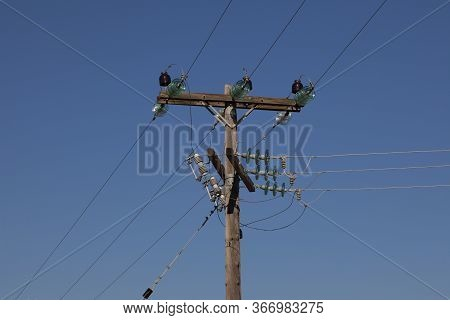 A Utility Pole Or Telegraph Pole Used To Support Street Lights, Power Lines, Electrical Cable And Ot