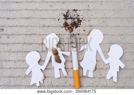 Paper Cut Of Family Members Destroyed By Cigarette. Smoking Destroying Family Concept. Quit Smoking