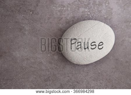 Pause Handwritten On A Yoga Zen Stone