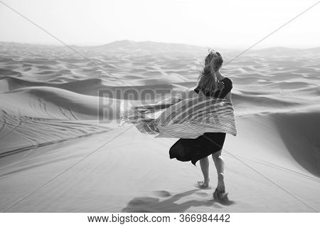 Photoshoot Of A Caucasian Girl In The Desert. Photoshoot Of A Caucasian Girl In The Desert. Black An