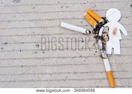 Paper Cut Of Man Destroyed By Cigarette. Smoking Destroying Life Concept. Quit Smoking For Life On W