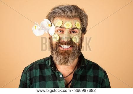 Funny Man Applied Facial Masks And Cucumbers On Face. Funny Surprised And Crazy Comic Concept. Facia
