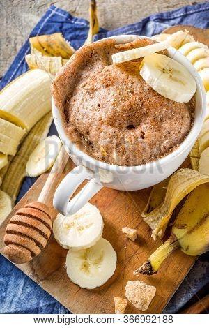 Portioned Banana Bread Mugcake In Small Mugs. Easy Sweet Baking Idea, With Fresh Bananas, Nuts, Hone