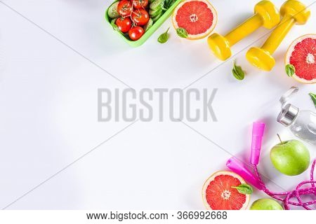 Fitness And Healthy Food Lifestyle Concept. Dumbbells, Diet Fruit And Vegetable Lunch Box, Water And