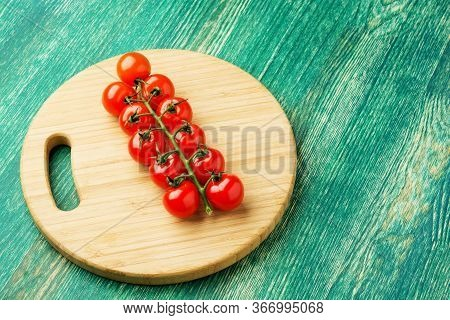 Cherry Tomatoes On Rustic Wooden Background With Copy Space.