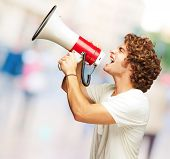 Portrait Of Young Man Shouting With A Megaphone, Outdoor poster