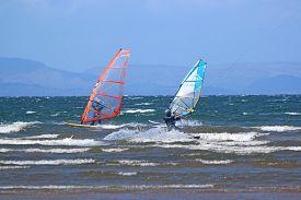 Kitesurfer And Windsurfers Riding At Troon, Scotland
