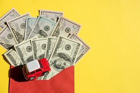 Car Model And Us Banknotes, Coin. Car Loan, Financial, Saving Money, Insurance And Leasing Time Conc