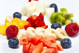 Modern Fresh Fruit Salad On White Plate. Mixed Fruit In White Plate Healthy Food Style. Useful Fruit