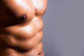 Strong Man With Athletic Body. Men Abs. Fitness Abdominal Muscle. Man Six Pack