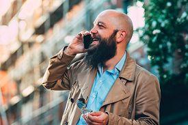 Man Portrait With Cell Phone. Man Portrait While Speaking On Cell Phone. Man Portrait Speaking On Ph