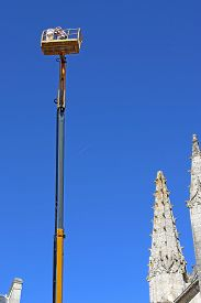Cherry Picker Working On Notre Dame Church, Fontenay-le-comte, France