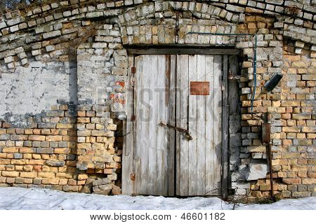 Brick Wall And Old Wooden Door