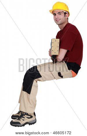 Carpenter sat with electric sander