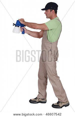 Man using paint sprayer