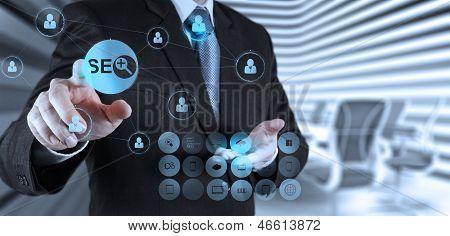 Businessman Hand Showing Search Engine Optimization Seo