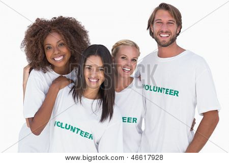 Smiling group of volunteers on white background