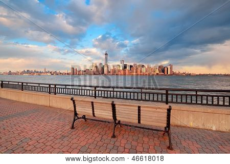 Downtown Manhattan skyline at sunset over Hudson River in New York City poster