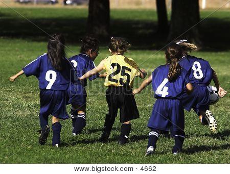 Girls Running After Ball