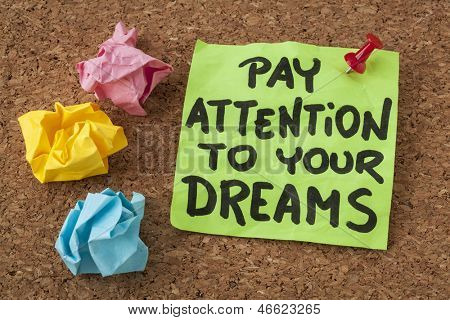pay attention to your dreams - motivation or self improvement concept - handwriting on colorful sticky notes poster