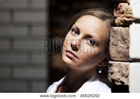 Sad beautiful woman on the night city street
