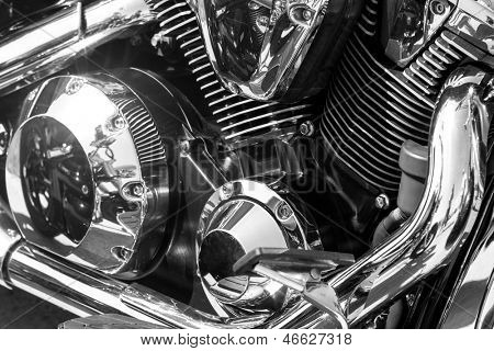 Closeup of chromed motorcycle engine poster
