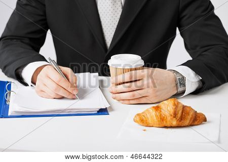 businessman on his coffee break making notes
